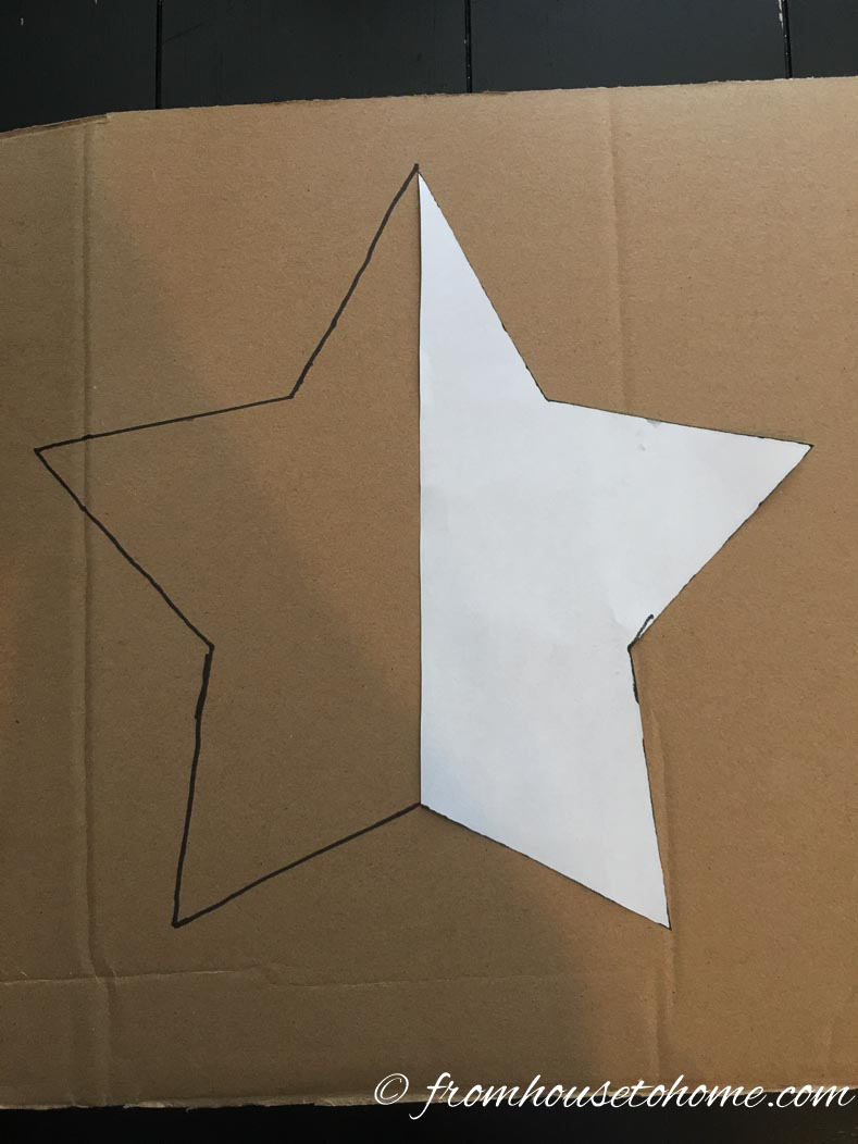 Star pattern being traced onto cardboard to make template for patriotic painted lawn decorations