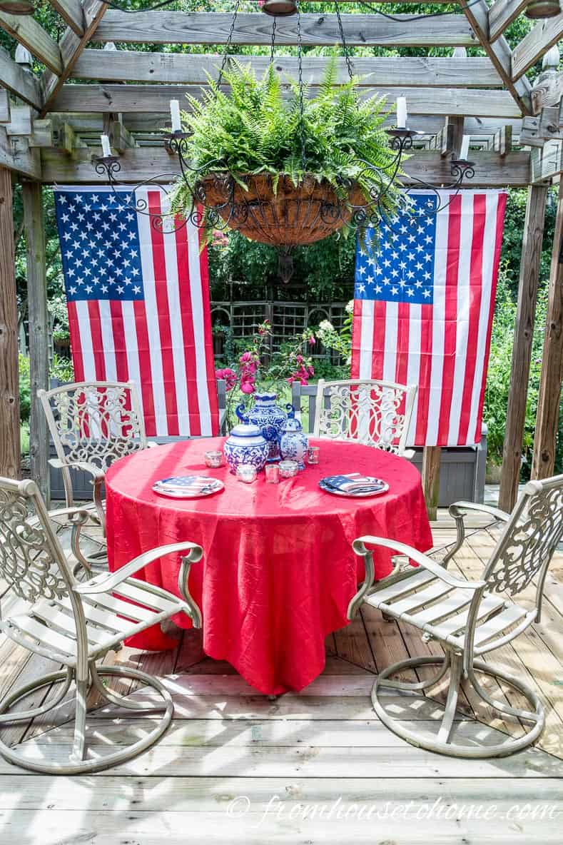 Hang flags sideways from the sides of the gazebo to act like curtains for easy 4th of july outdoor decorating ideas