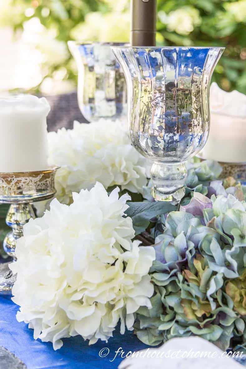 Faux flower center piece | 10 Creative Summer Party Ideas for easy entertaining | If you don't have a lot of time to spend decorating your backyard, these creative summer party ideas are fast and easy to do but still look beautiful.