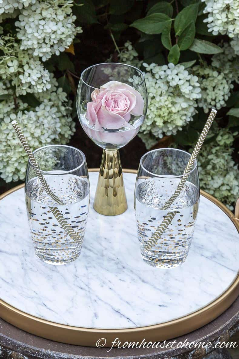Float flowers | 10 Creative Summer Party Ideas for easy entertaining | If you don't have a lot of time to spend decorating your backyard, these creative summer party ideas are fast and easy to do but still look beautiful.