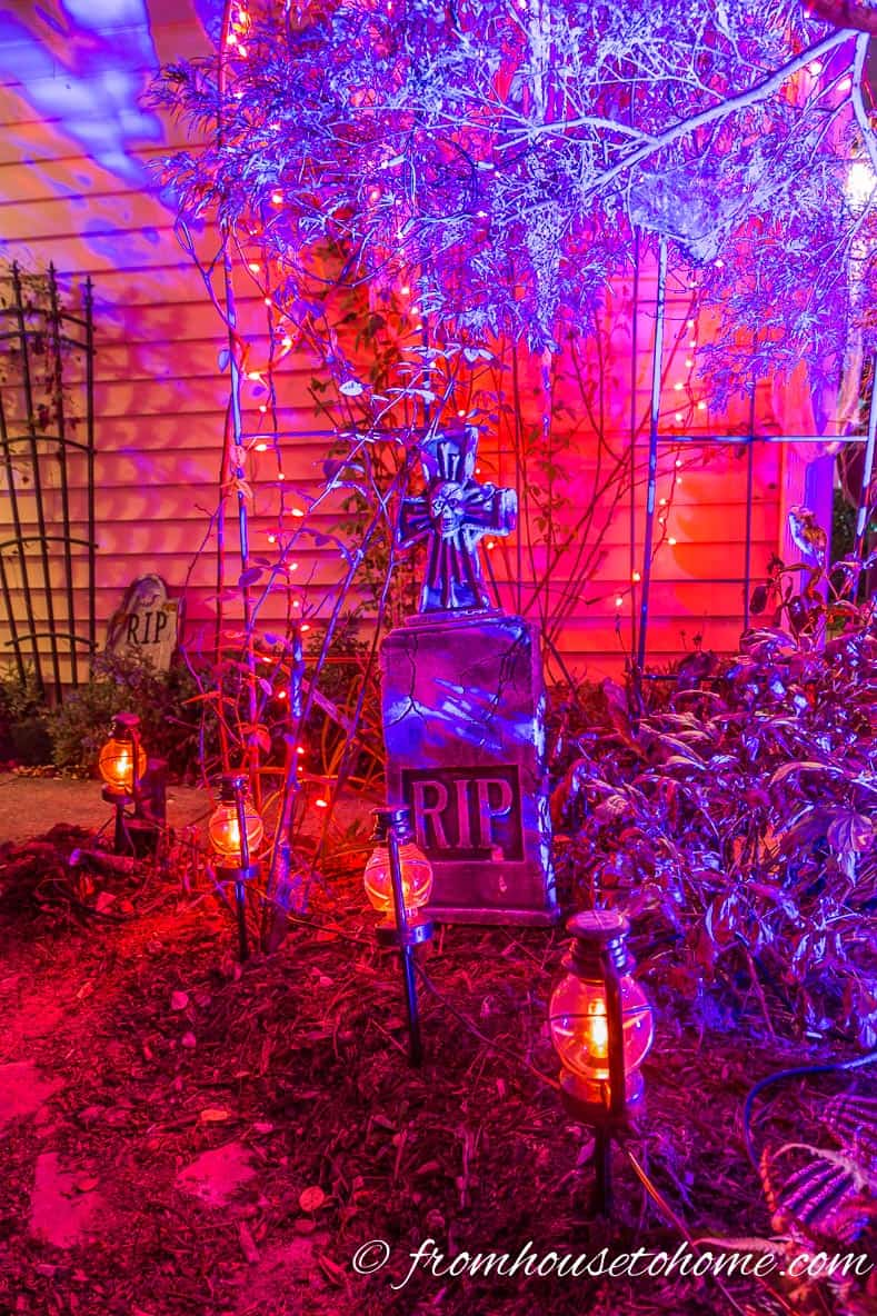 Purple and orange Halloween outdoor lighting with Halloween tombstone and path lighting
