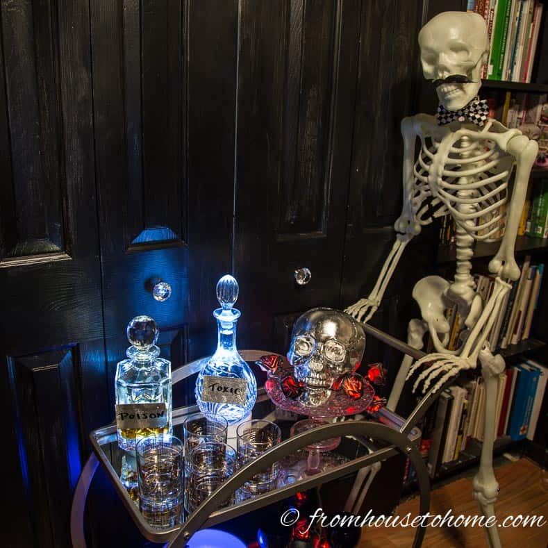 Skeleton behind a Halloween bar cart