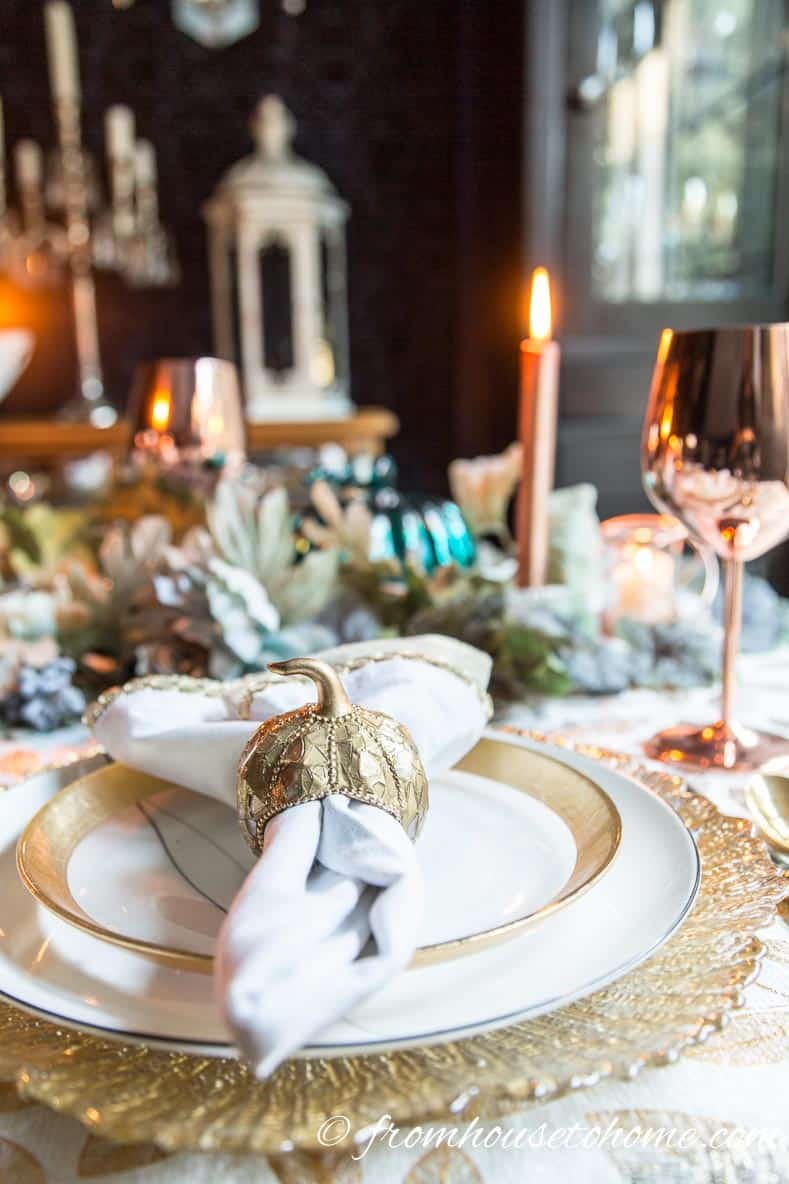 Gold and copper table setting with pumpkin napkin ring