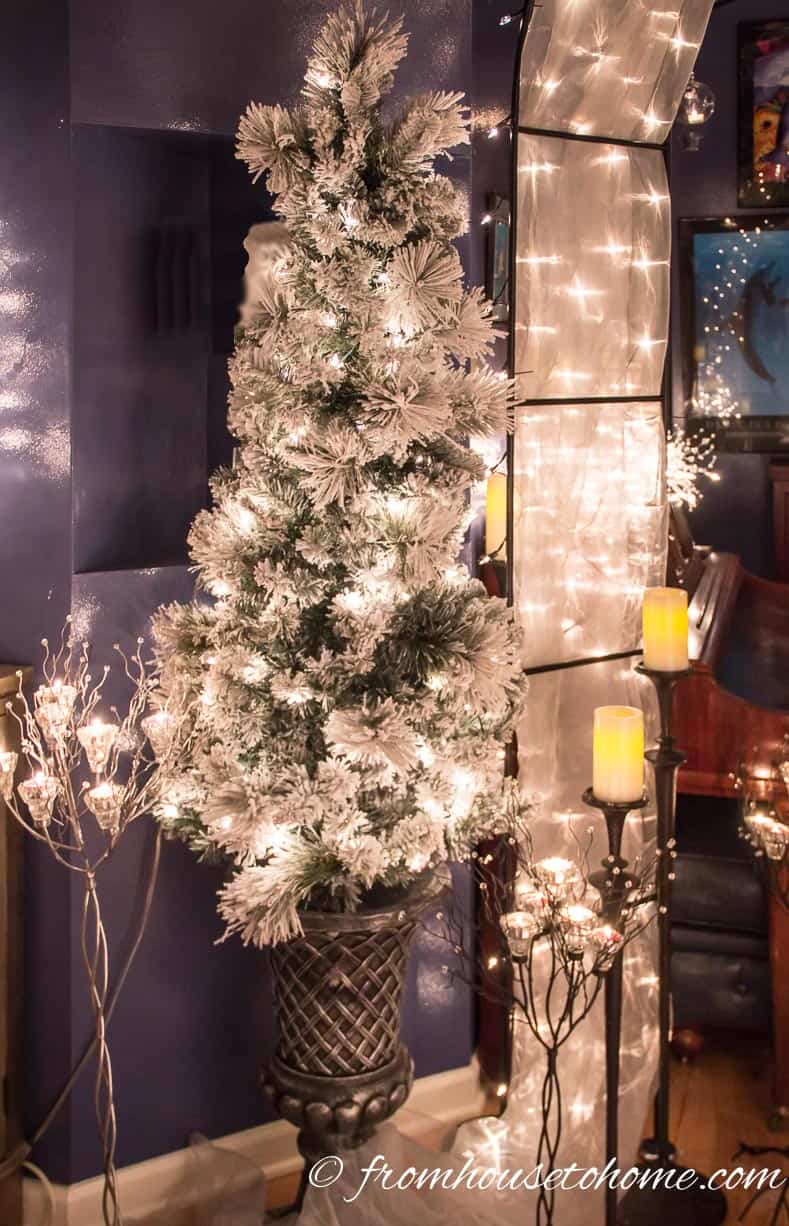 Flocked Christmas trees are perfect decorations for a Winter Wonderland party
