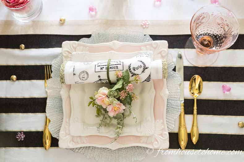 Blush pink place setting with gold cutlery and pink wine glass