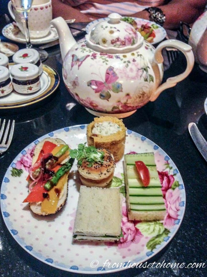Tea party food on a plate with a teapot