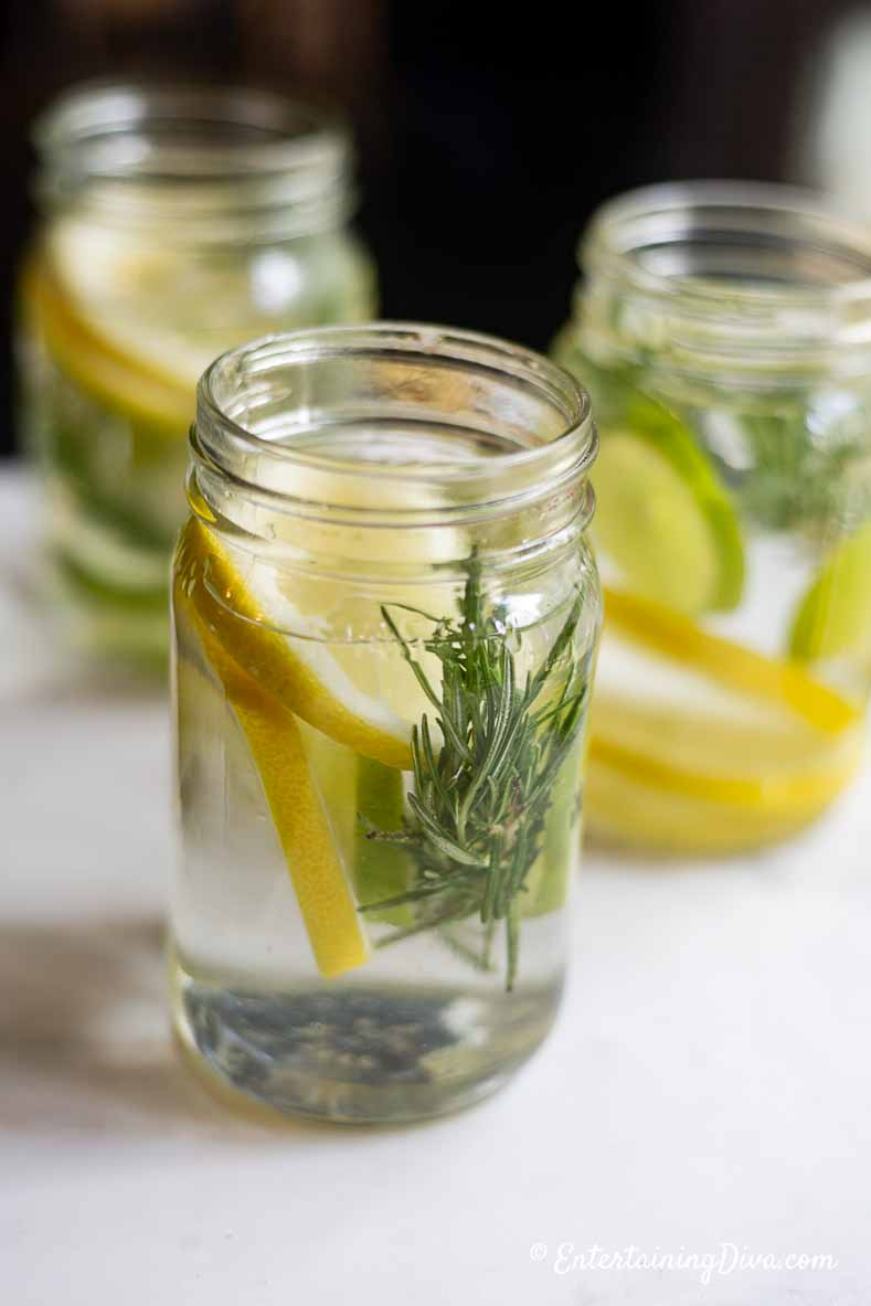 DIY Citronella candle ingredients in mason jars filled with water
