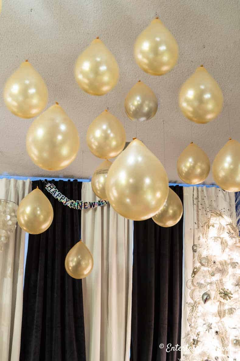 Kate spade themed party decor ideas gold balloons hung from the ceiling