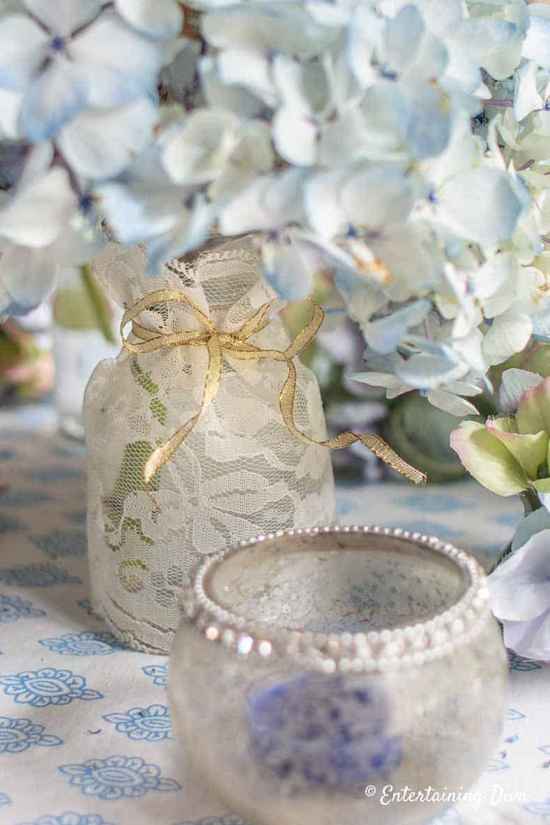 White lace vase with blue hydrangea