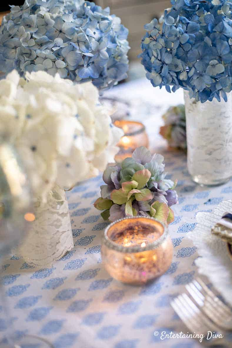 Blue and white hydrangeas on a blue and white tablecloth