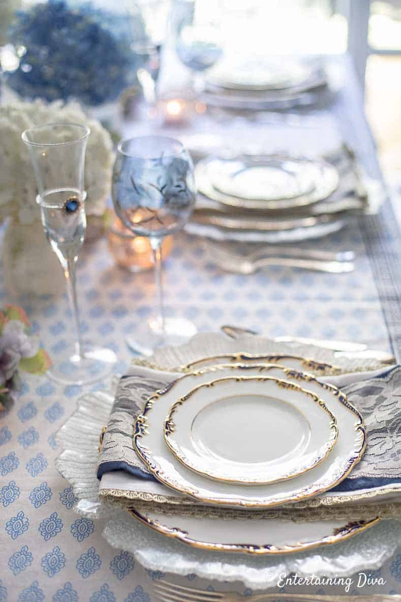 Blue and white place setting, napkins and wine glasses