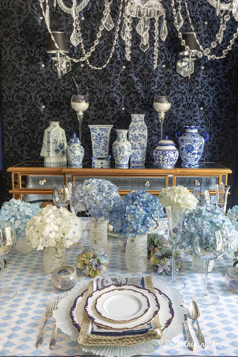 Blue and white summer table setting with blue and white Chinoiserie ginger jars on the buffet