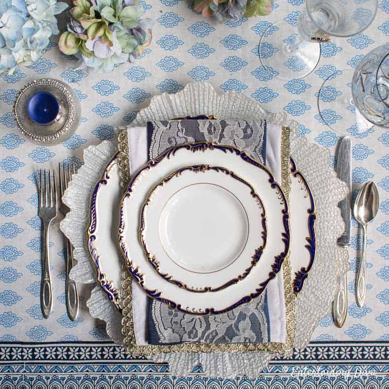 Blue and white place setting on a blue and white summer tablescape
