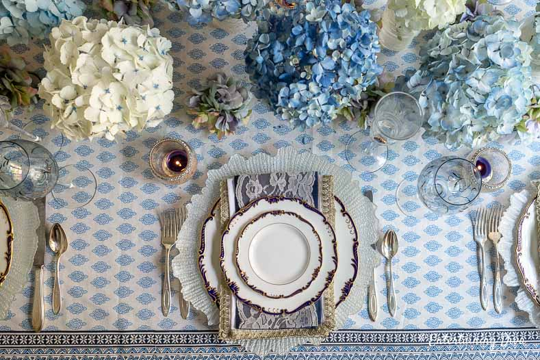 Blue and white place setting with blue and white hydrangeas