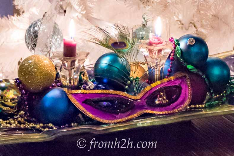 Masks, Christmas ornaments and Mardi Gras beads can be used as a centerpiece