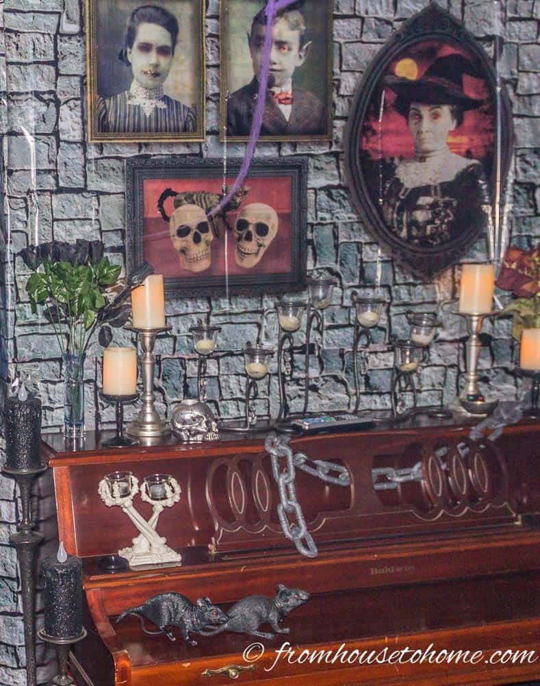 Layer Halloween scene setters to add more interest (like these pictures over the stone wall)
