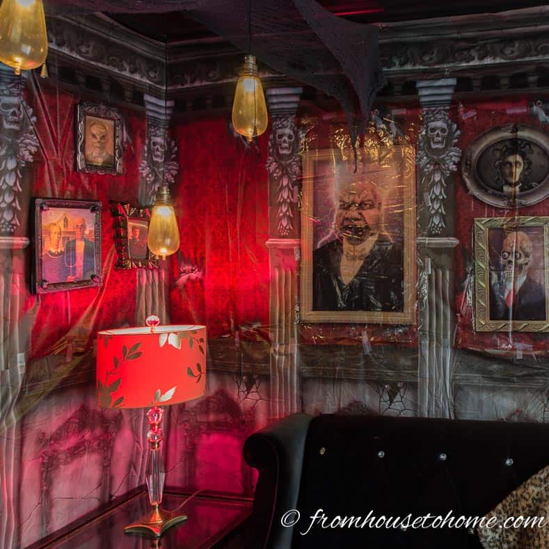 Halloween haunted house scene setter hung on a den wall