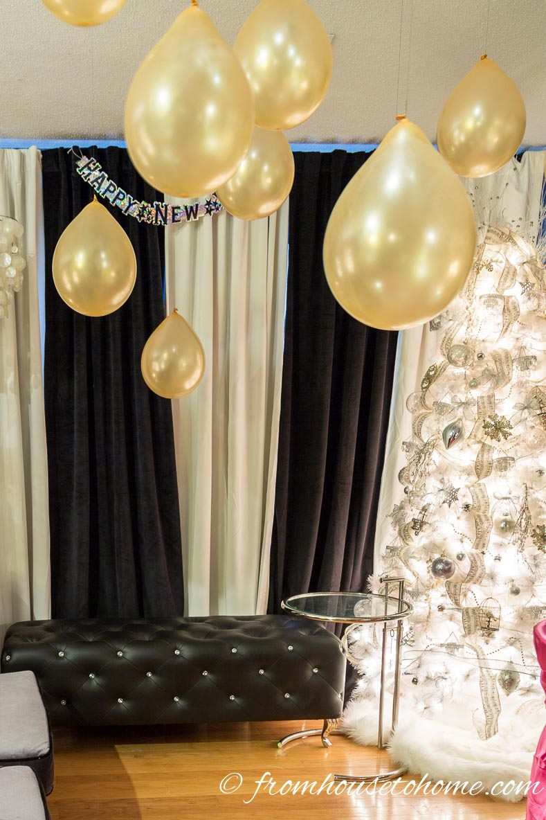Black and white curtains with gold balloons