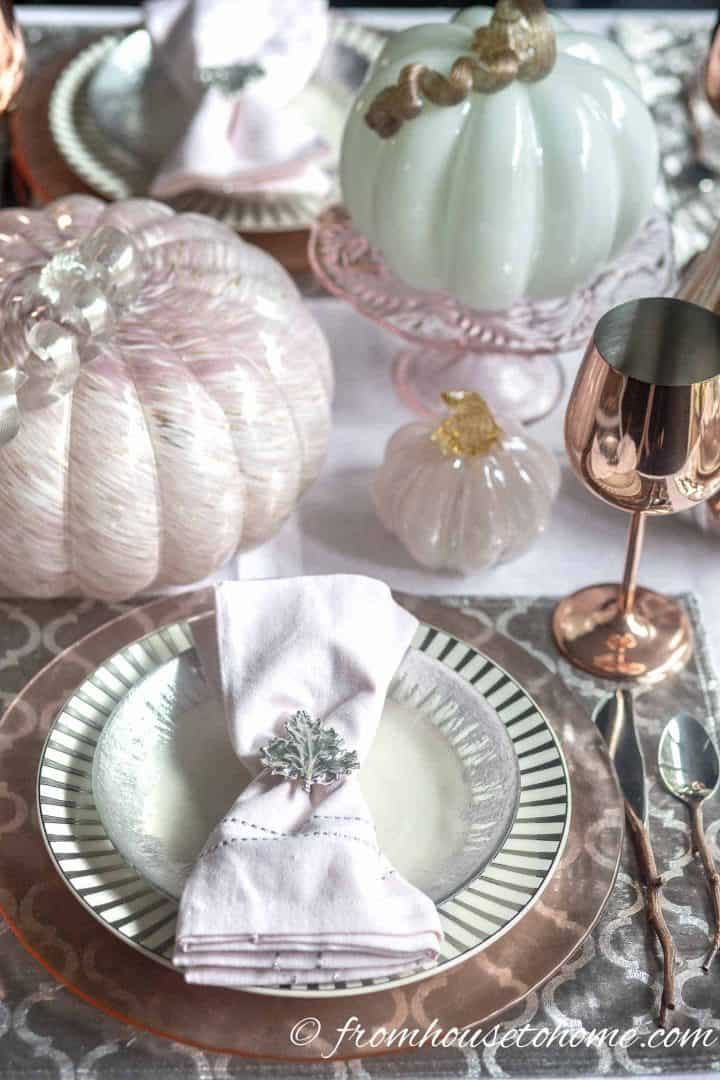 Pink and silver fall tablescape with copper wine glass