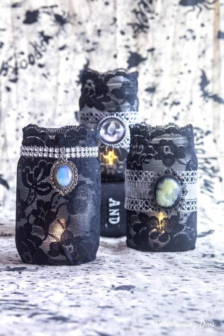 Halloween mason jar candle holders made with black lace and pendants