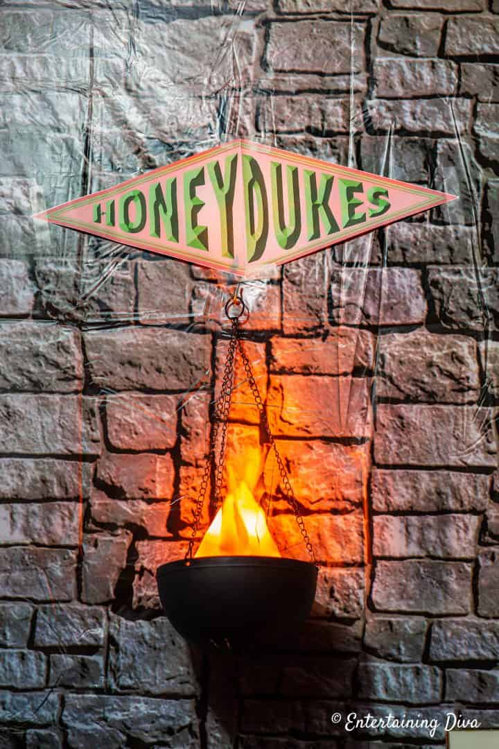 Harry Potter party Honeyduke's sign with flame