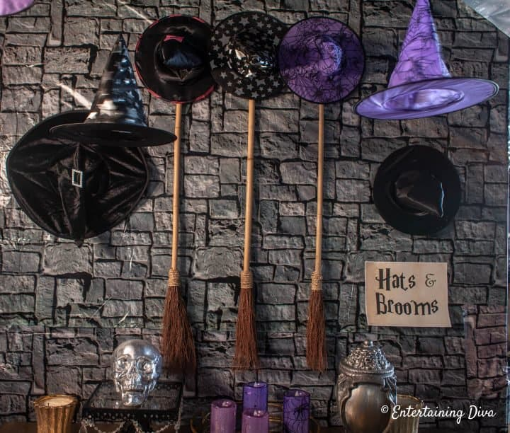 Harry Potter party ideas - witch hats and broom sticks on the wall