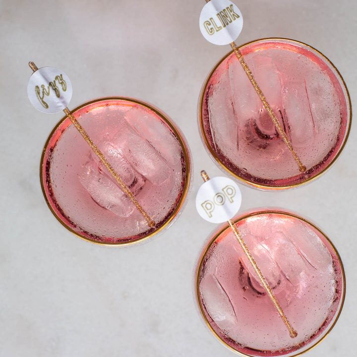 Pop, Fizz, Clink drink stirrers in champagne cocktails