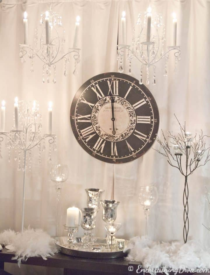 A clock surrounded by candles for a last minute New Year's Eve party decoration