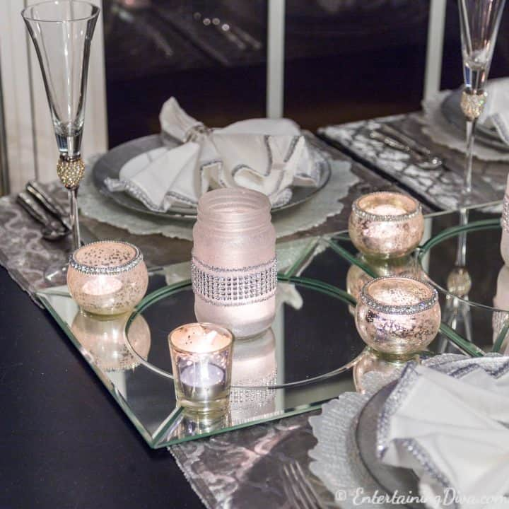 DIY frosted glass mason jar candle on mirror chargers as a last minute New Year's Eve Party decoration on a table