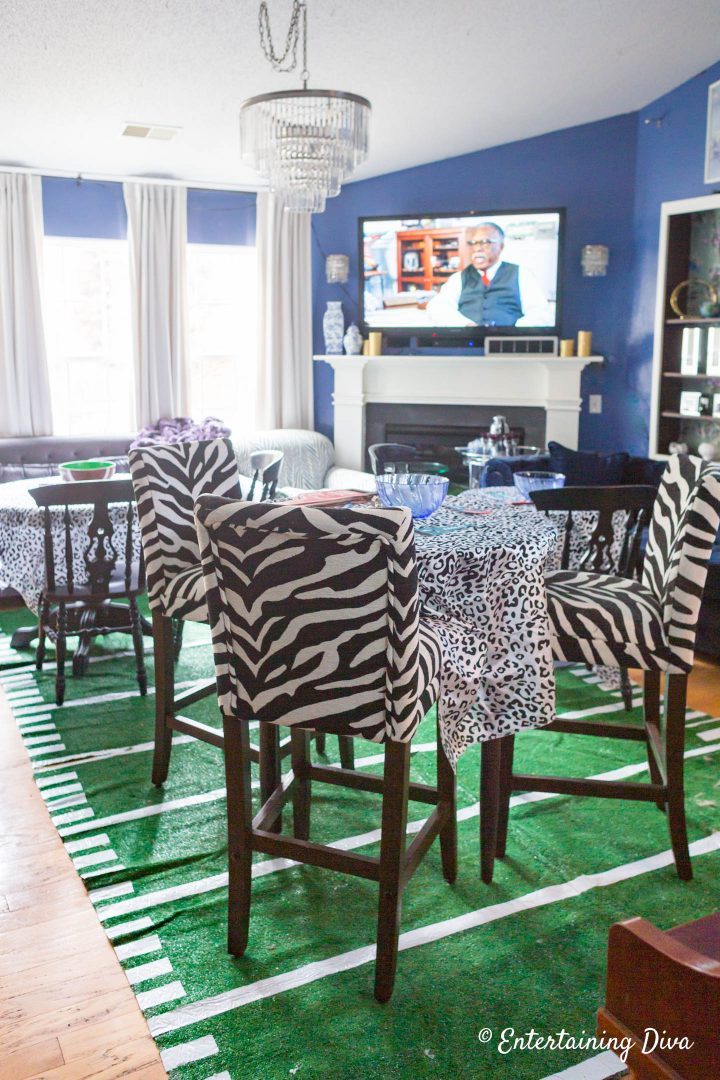 DIY football field area rug in the living room with the other super bowl party decorations