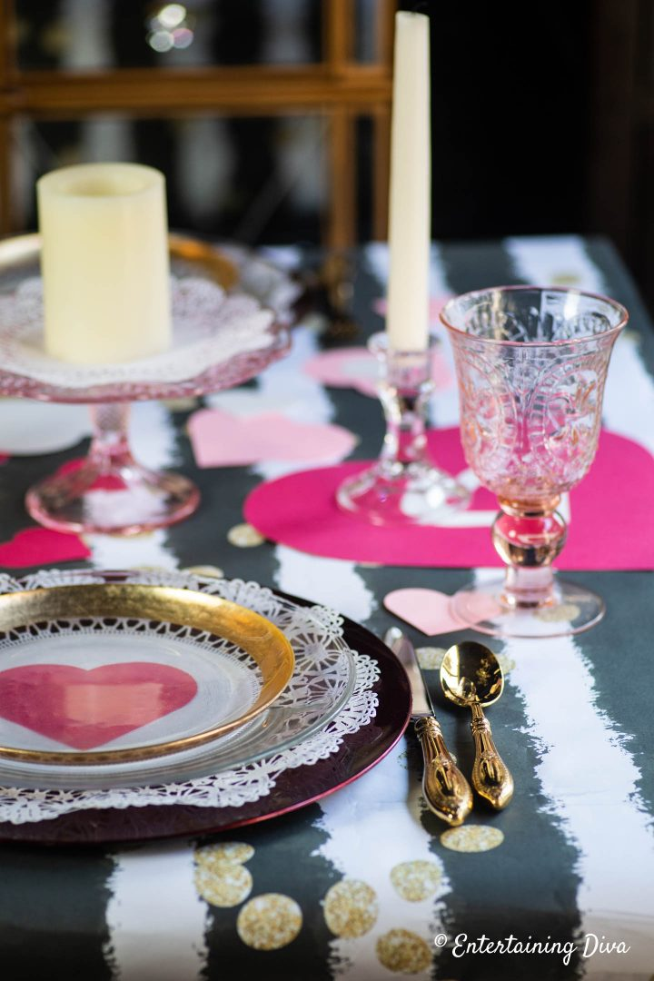 Valentine day table setting with pink water goblets
