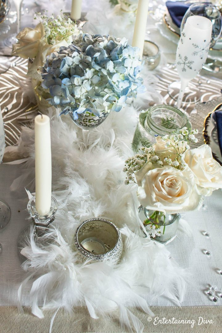 White feather boas on a winter wonderland tablescape