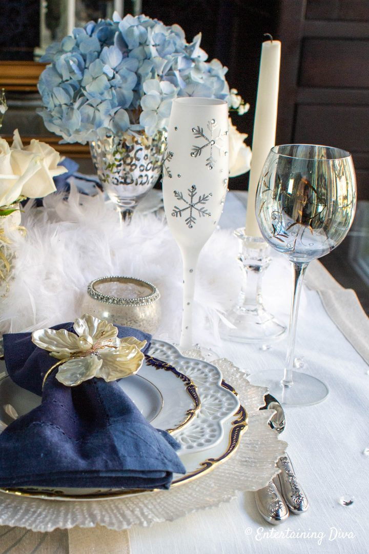 Winter wonderland place setting with snowflake wineglass and blue hydrangeas
