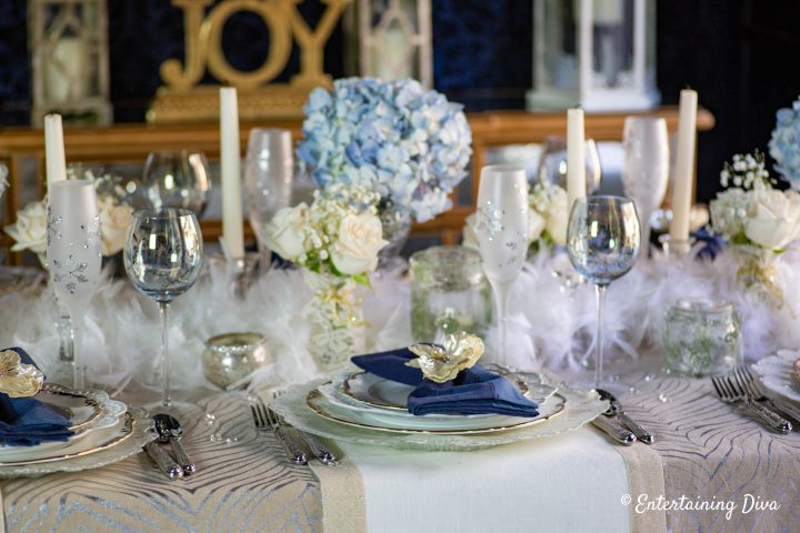 Blue, white, silver and gold winter wonderland table decor