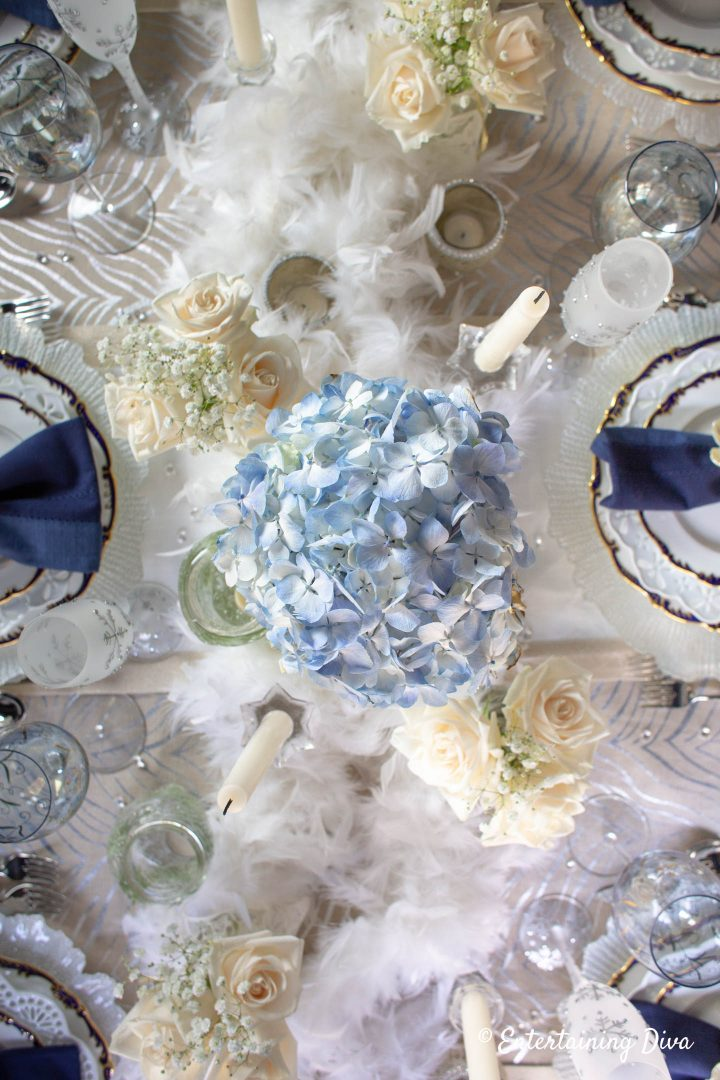 Blue hydrangeas and white roses in a winter wonderland table setting