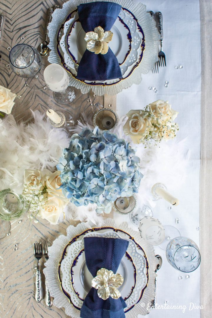 Winter wonderland table decor with place settings and flowers