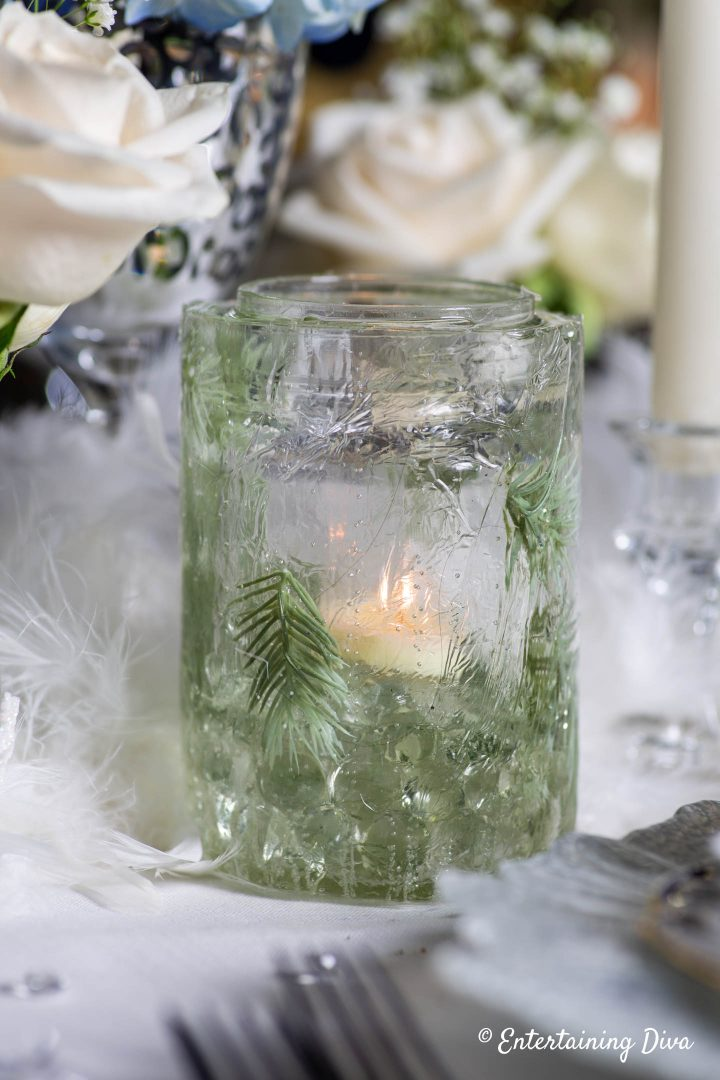 DIY ice candle holder with evergreens made from a mason jar