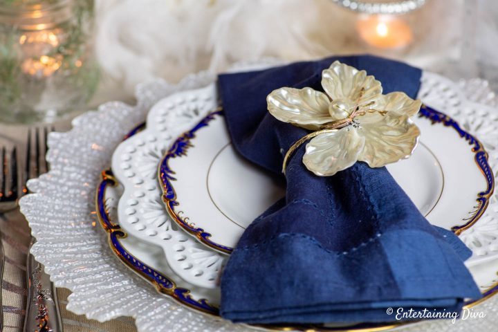 White, blue and gold place setting as winter wonderland table decor