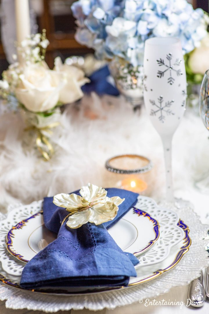 White, blue and gold winter wonderland place setting with snowflake flute