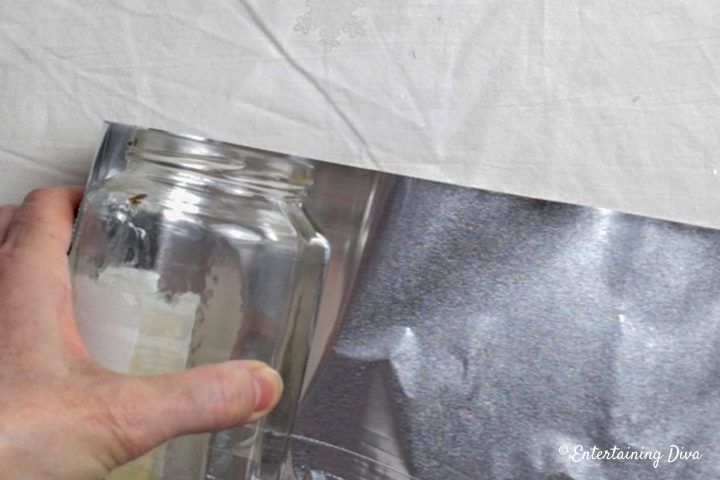 Line the foil up with the top of the mason jar