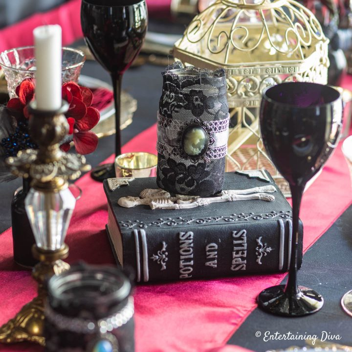 Spell book and candles for Harry Potter table decor