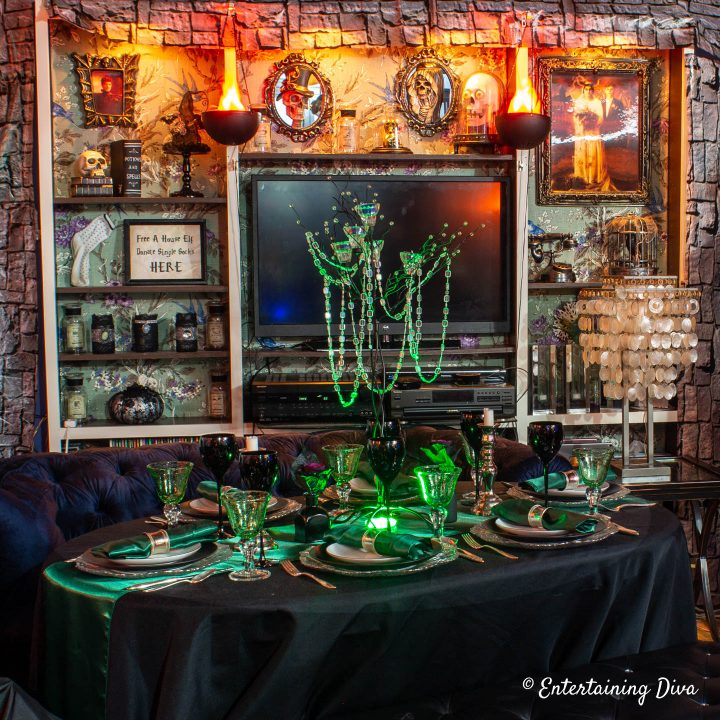 Slytherin house candle tree centerpiece with a green uplight