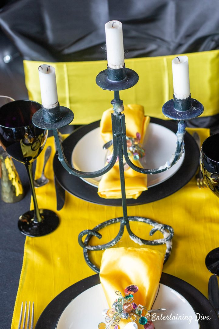 Black candelabra as the centerpiece for Harry Potter Hufflepuff House table decor