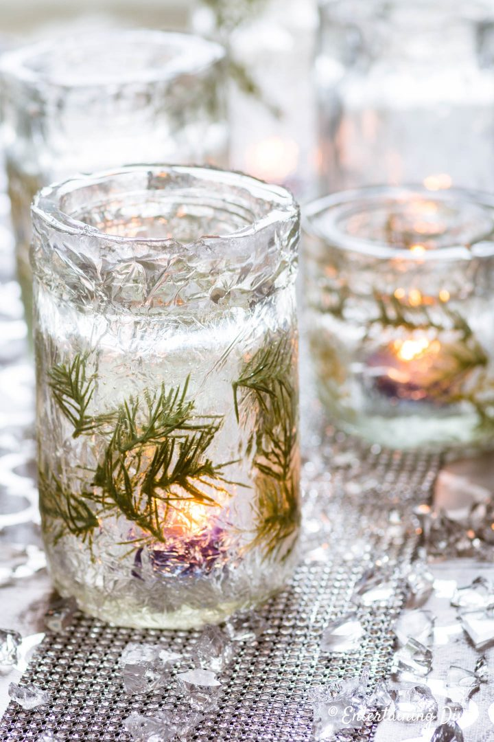 DIY winter wonderland decor: faux ice candle holders with lit candles and faux ice table scatter