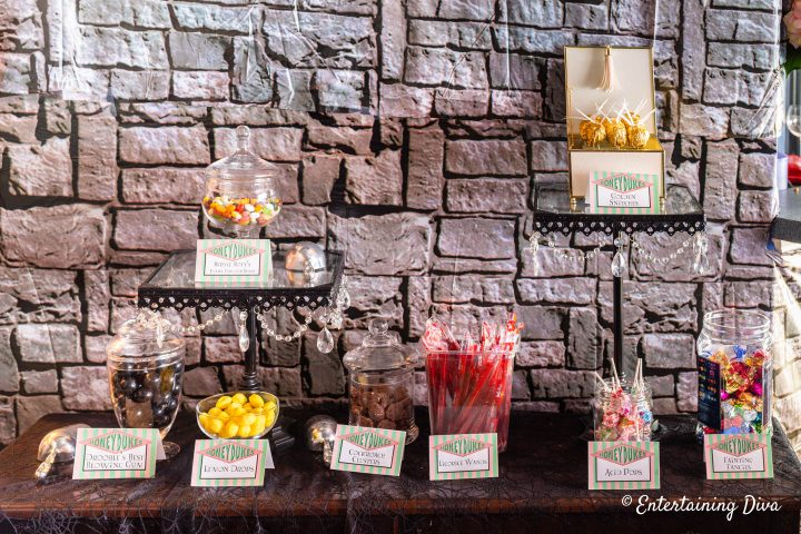 DIY golden snitches displayed in a Honey Dukes candy bar at a Harry Potter party
