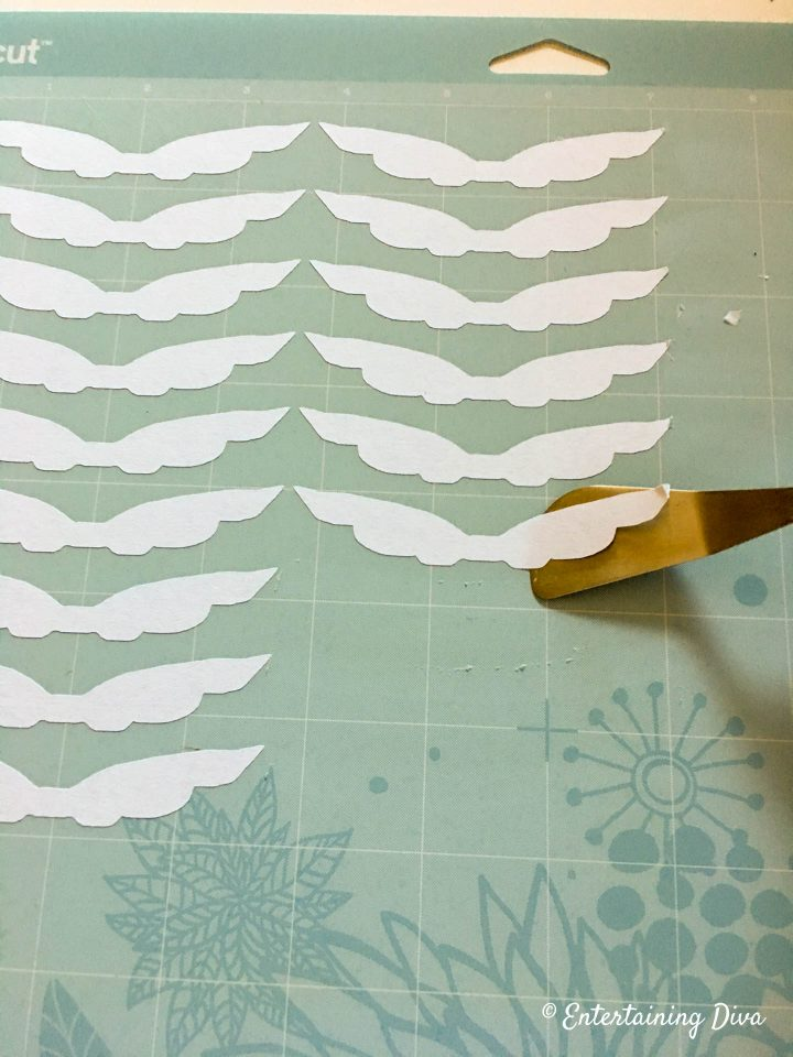 Golden snitch wings cut out on Cricut