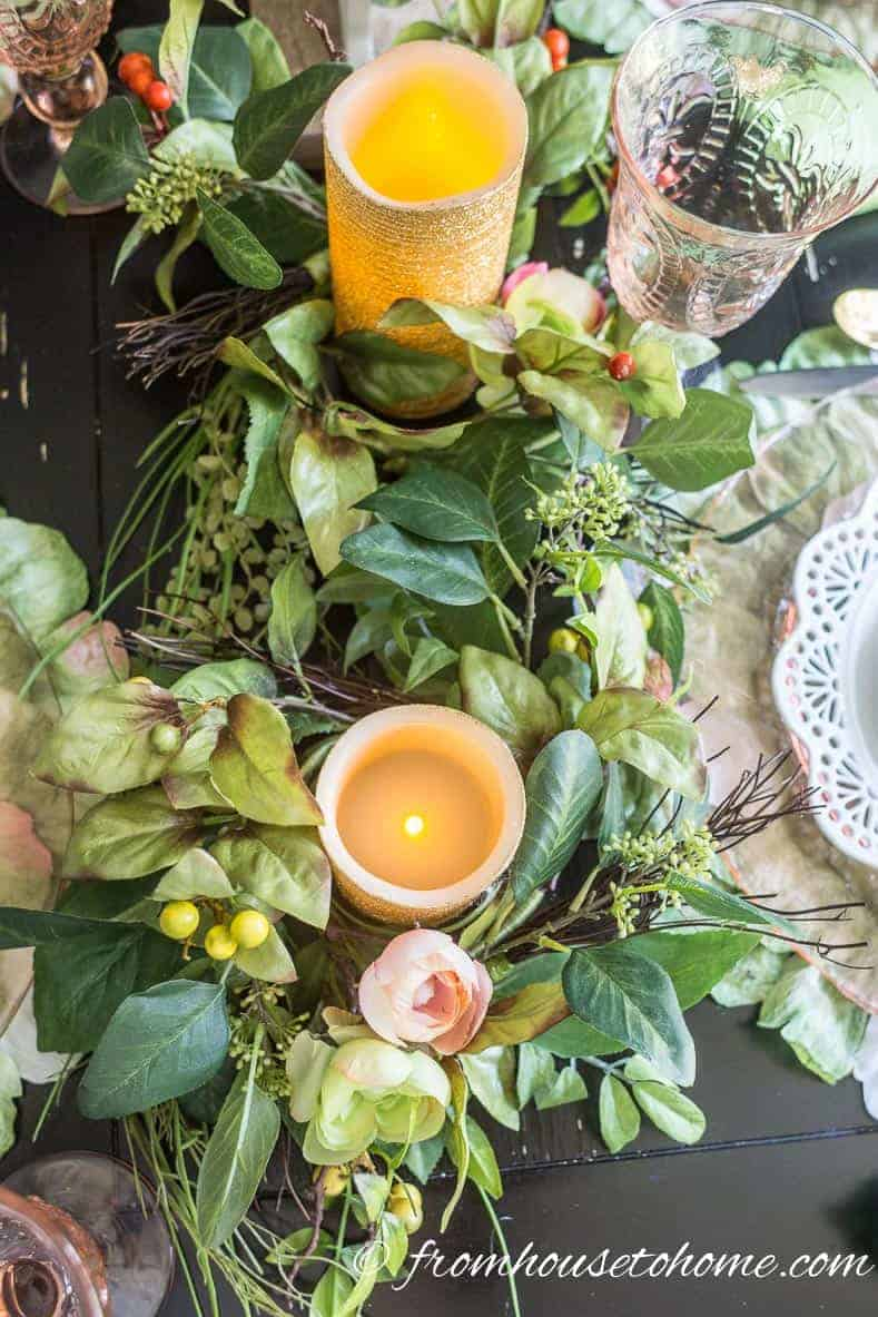 Candles and greenery finish off the Easter table decorations