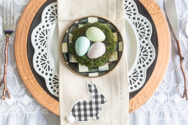 Black, white and copper Easter table place setting with buffalo check Easter bunny on the napkin