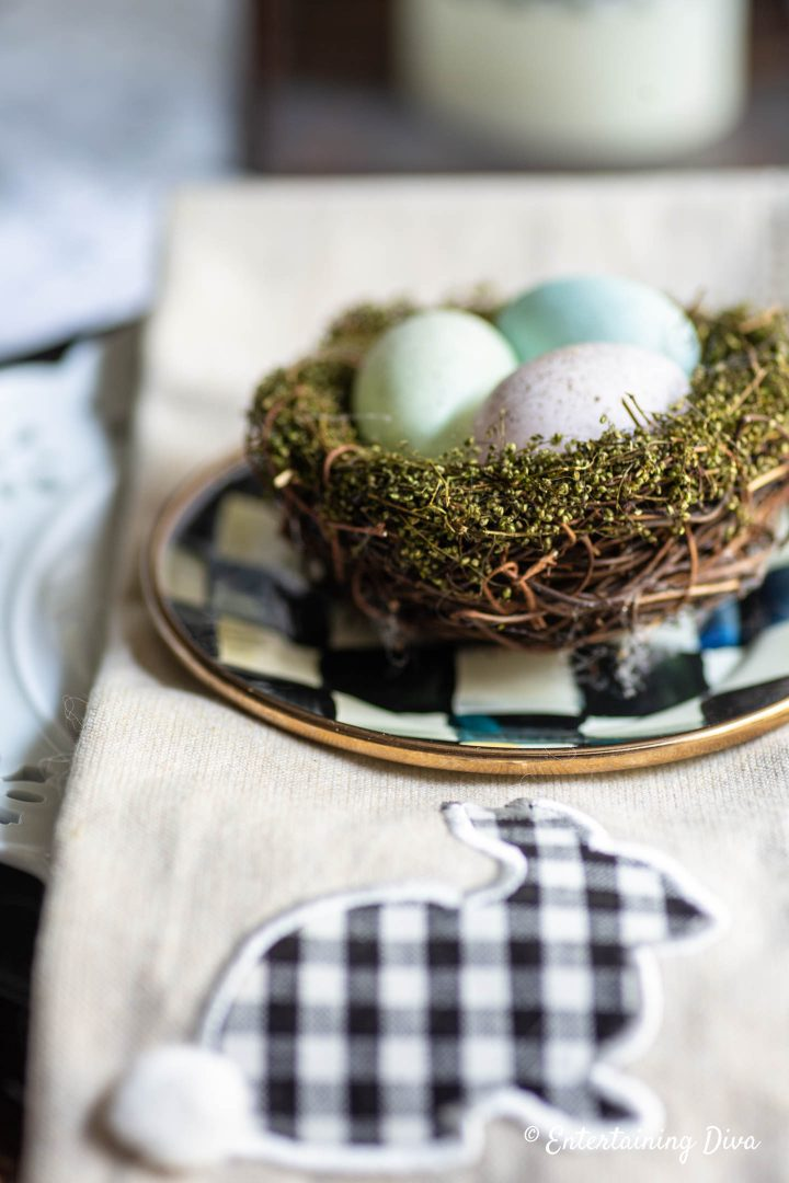 Easter egg nest on top of appetizer plate and napkin