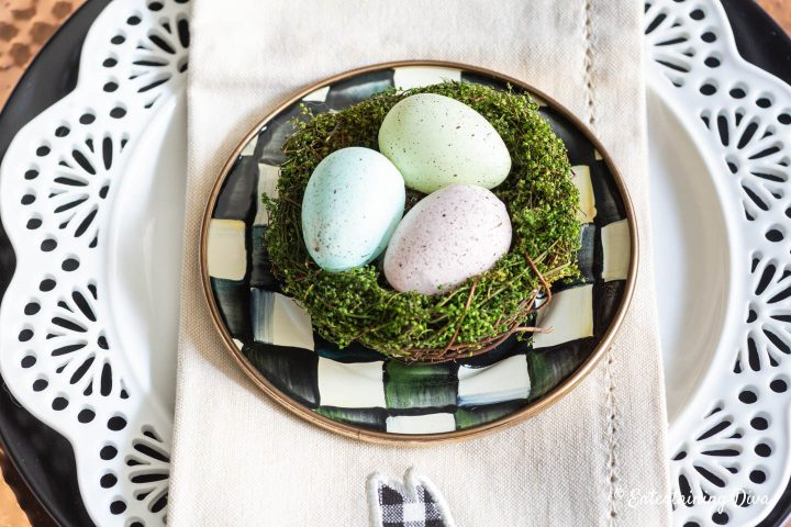 Easter egg nest on top of black and white appetizer plates
